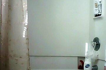 Hot brunette in shower
