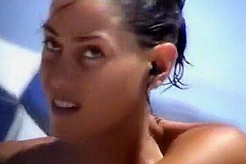 Debora Bello topless at the beach