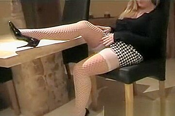 wife in panties gives upskirt views of her nylons and knickers
