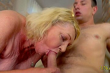 Horny blonde granny enjoys hard cock in her pussy