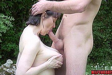 Brunette milf outdoor with cum on ass