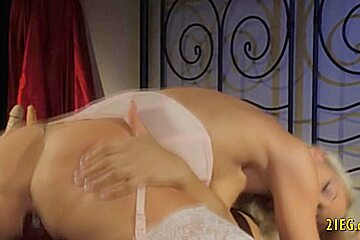 Lesbians in sexy lingerie use strapon to fuck