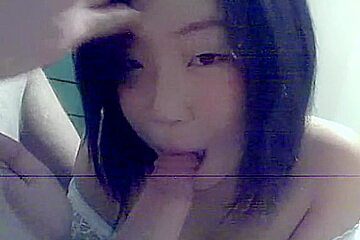 Adorable Asian girlfriend giving special oral treatment