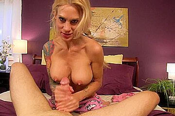 Toned busty blonde slut Sarah Jessie gives a handjob