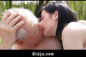 Young brunette fucks a nudist grandpa in the park