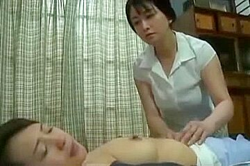 Japanese MILF babes in lesbian action