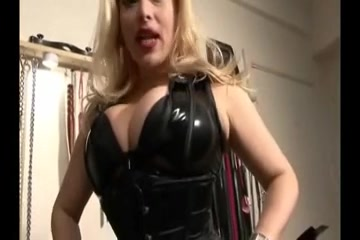 Busty blonde domina teases in kinky outfit