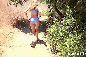 Blonde MILF shows off body on public trails