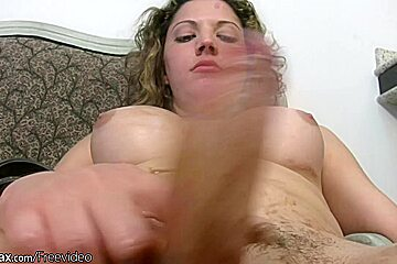 Striking shemale with curly hair strokes her thick cock