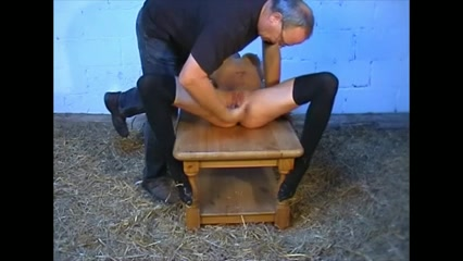 Tied up slave gets whipped by  ...