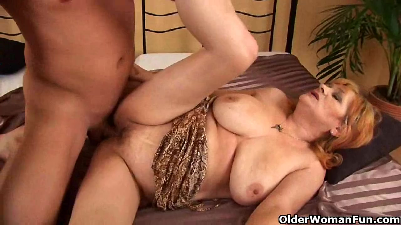 Redheaded granny with large titties sucks strapon and receives drilled filestube chubby titty girl fucked fisted
