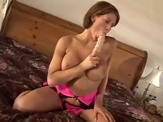 Breasty brunette hair shoves a weenie shaped sex tool up her obese wet crack and groans on ottoman