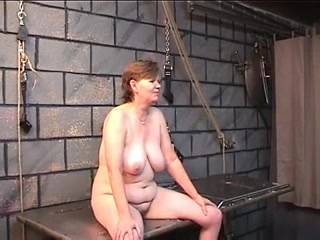 Old wenchs bawdy wazoo goes red from spiked glove flogging in dungeon naked woman bending over