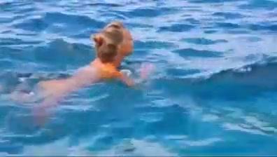Nude beach - hot blond posing on the rocks