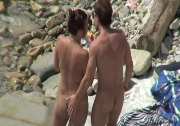 Interesting in natures garb couple on the beach Naked caught spy cam