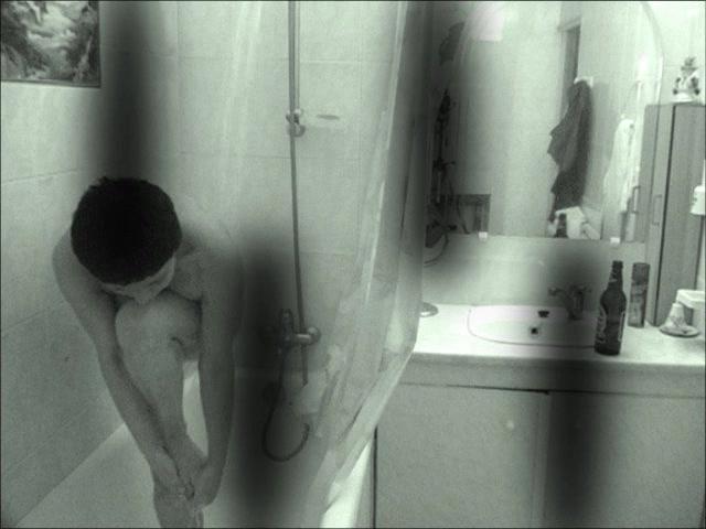 Hidden brunette in shower