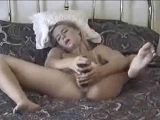 Shapely charmer masturbated with a big homemade dildo on the bed Best Of Amateur Porn