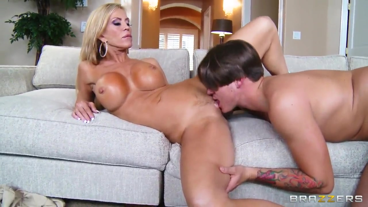 Amber Lynn in hot couch sex with Bradley Remington