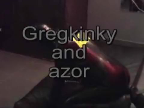 rubber doggie girl with strapon and guy fucking a guy