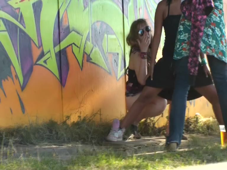 Girl on hunkers trying to piss while covered by her friend Full Movie Pussy