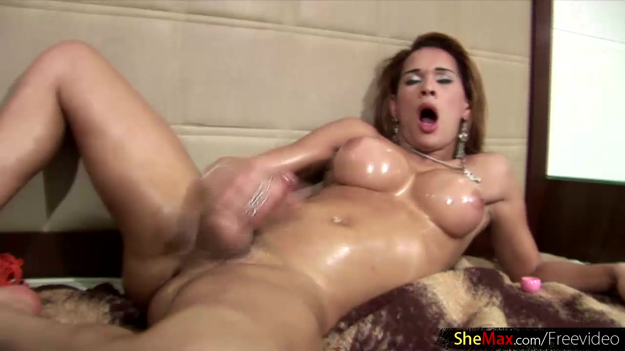 Big ass TS shakes up her shaft and fondles oiled body