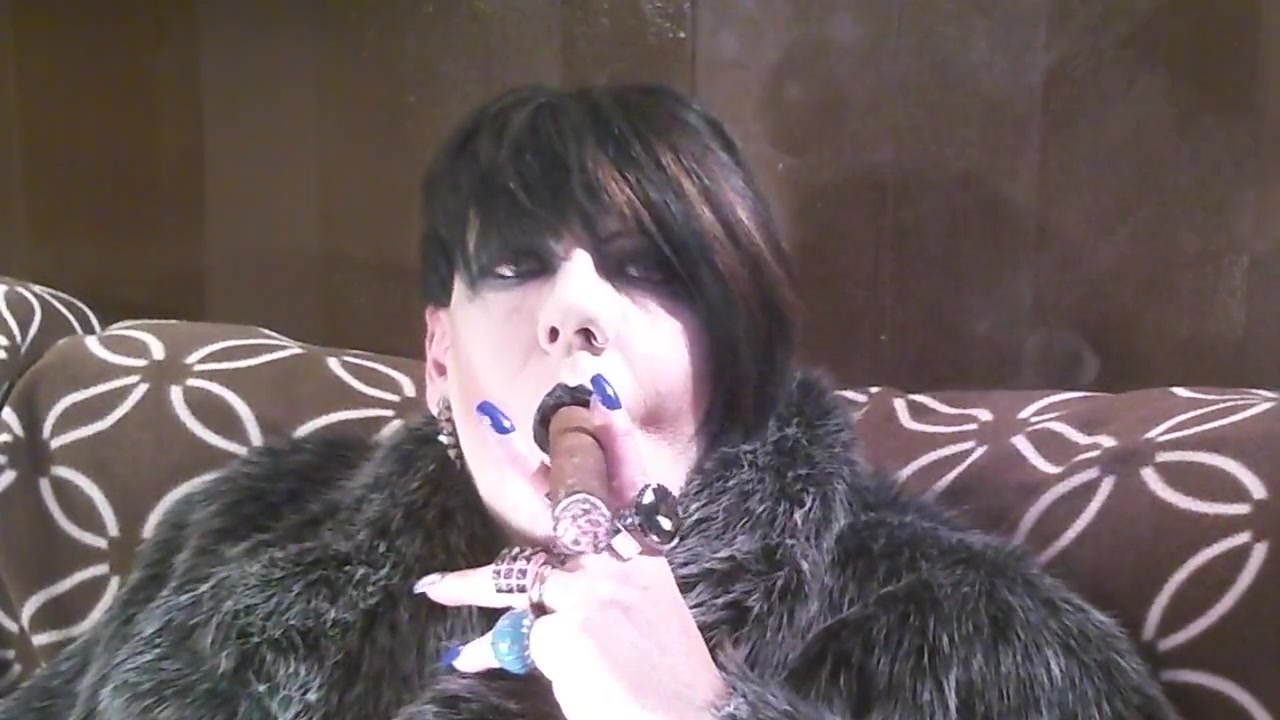 Fur and a cigar. Lesbian babe in stockings pussylicking